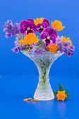 Vase with bouquet of flowers — Stock Photo