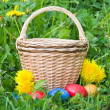 Colourful easter eggs and a basket — Stock Photo #1654968