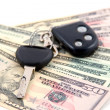 Car key and dollars isolated on white — Stock Photo