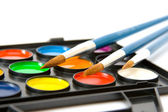 Water color paints with brushes — Stock Photo