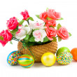 Royalty-Free Stock Photo: Roses in a basket and Easter eggs
