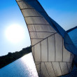 White sail against the sunset sky — Stock Photo #1619725