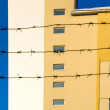 Stock Photo: Building behind barbed wire