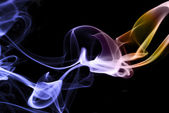Colored smoke abstract on black — Stock Photo