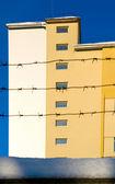 Building behind barbed wire — Stock Photo