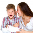 Happy young mum cheers sad son — Stok fotoğraf