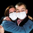 Stock Photo: Afraid mand womdressings mask