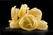 Heap raw dry nest pasta — Stock Photo