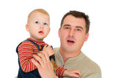Father and son look with open mouth — Stock Photo