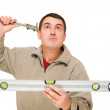 Man with level tool and trammel - Stock Photo