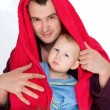 Father with a child wraps the towel — Stock Photo #2044580