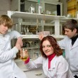 Young scientists  in laboratory — Zdjęcie stockowe
