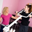 Two girls in the gym — Stock Photo