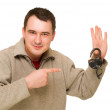 Man pointing to open lock — Stock Photo