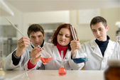 Men and woman in laboratory — Stock Photo