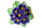 Purple beads flower with green leafs — Stock Photo
