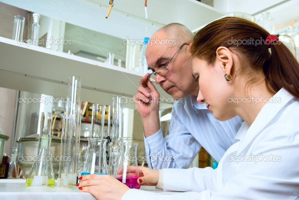 Scientists conducting research in the chemical laboratory  Stock Photo #2325578