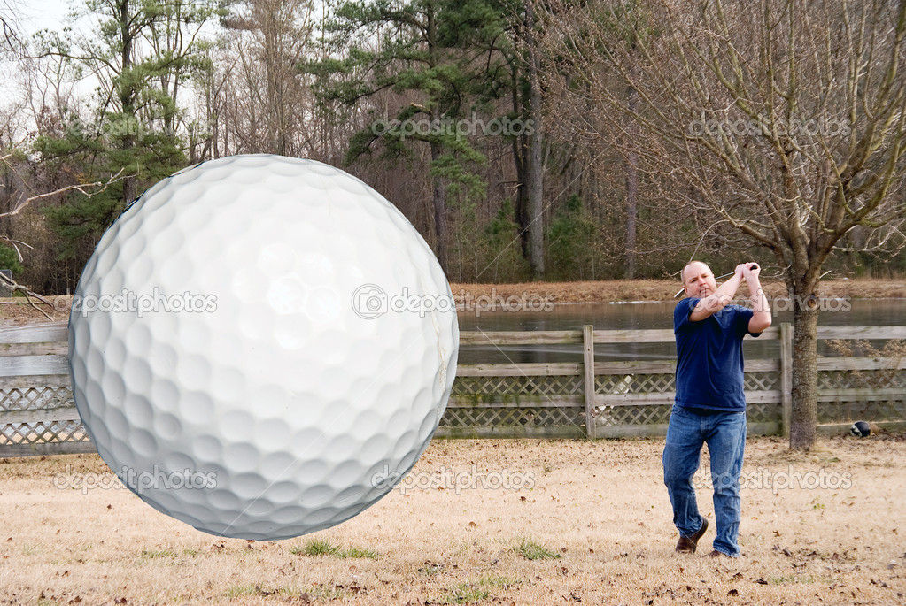 An airborne golf ball just after being hit.  Stock Photo #1601349