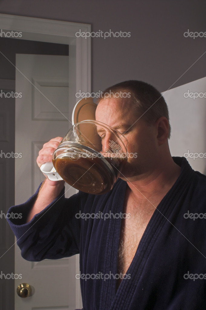 A man drinking coffee straight from the pot.  Stock Photo #1620327
