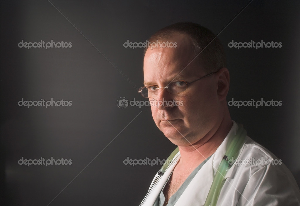 A medical doctor waiting on his next patient. — Stock Photo #1628278