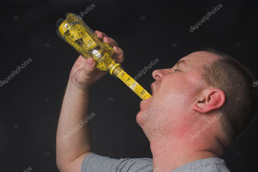 A man enjoying a beverage. Diet drink concept. — Stock Photo #1698067