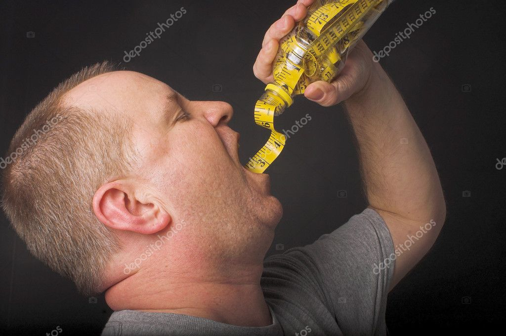 A man enjoying a beverage. Diet drink concept. — Stock Photo #1698126