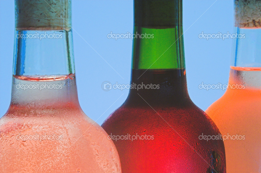 Several bottles of assorted wines ready for opening. — Stock Photo #1700577