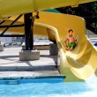 Boy on a Waterslide — Stock Photo