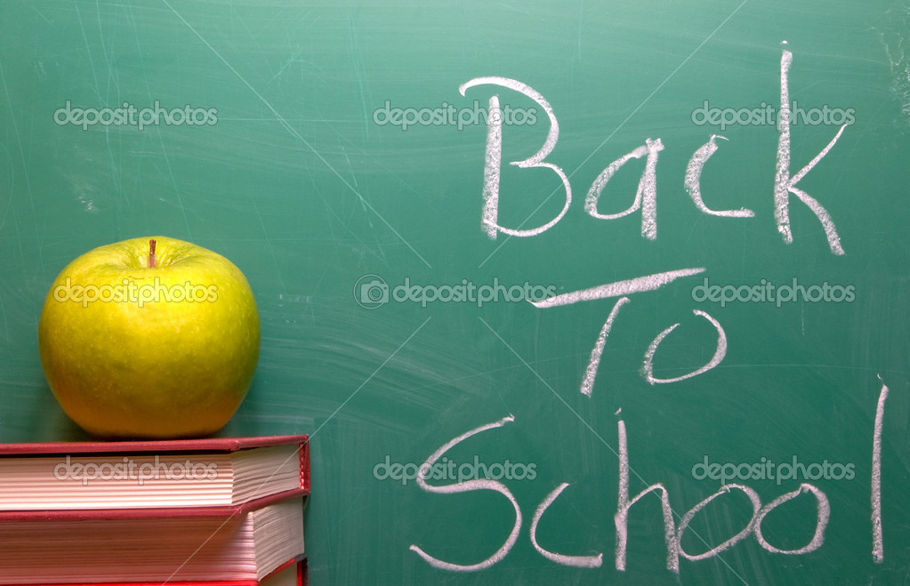 Back to School written on a chalkboard. — Stock Photo #1710313