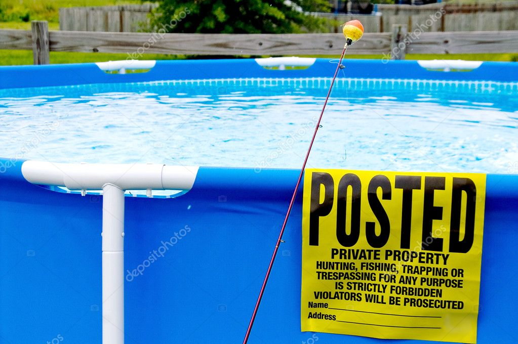 A posted sign on a swimming pool next to a fishing pole. — Stock Photo #1716210