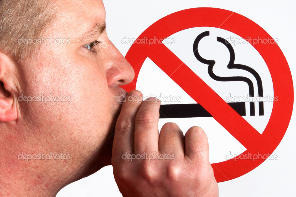 A man smoking a no smoking sign. — Stock Photo #1716949