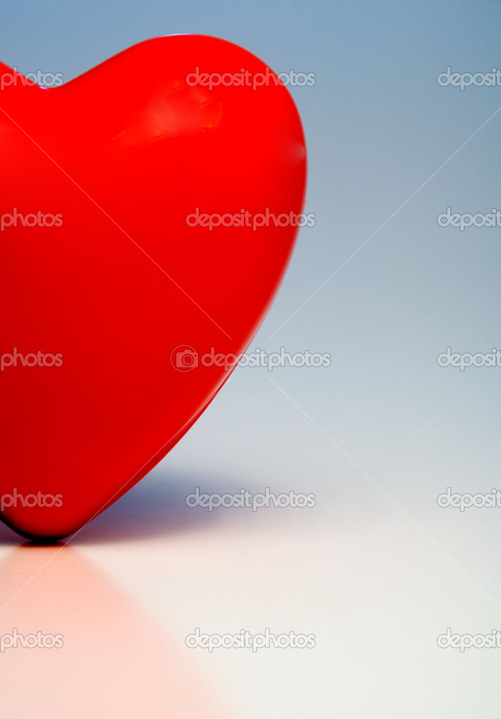 A big red heart ready for a beating.  Stock Photo #1733148