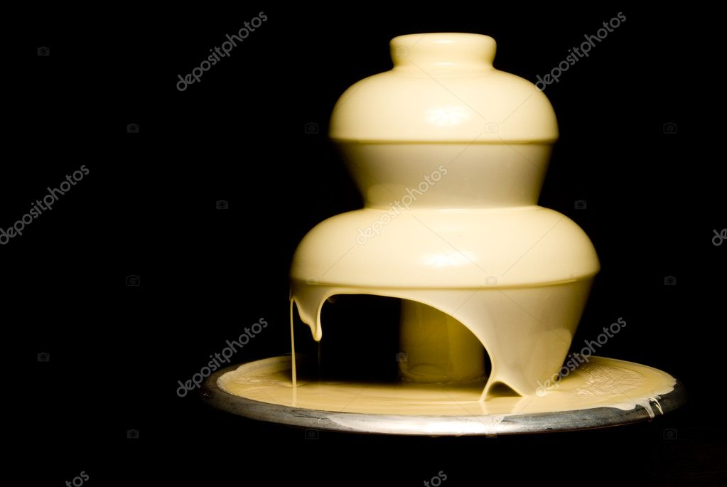 An elegant and gourmet white chocolate fountain.  — Стоковая фотография #1735164