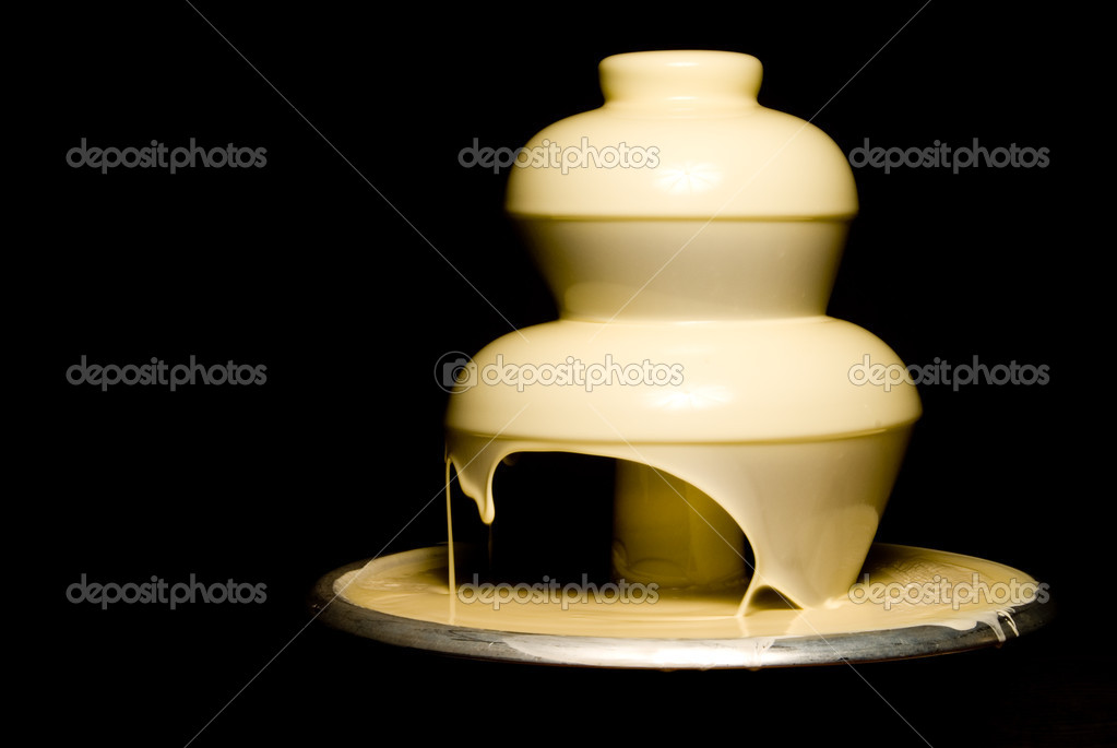 An elegant and gourmet white chocolate fountain.   Stockfoto #1735164