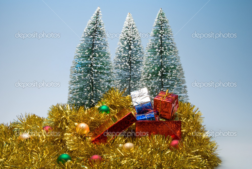 Several Christmas presents in festive holiday boxes. — Stock Photo #1738359