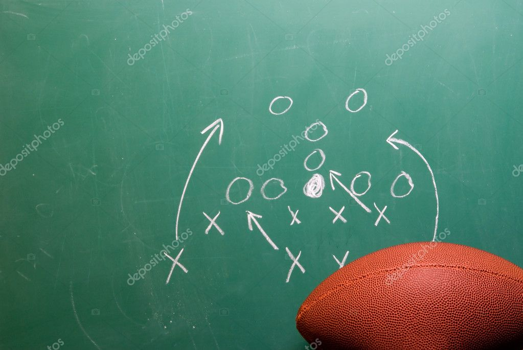 A coaches football play on a chalkboard. — Stock Photo #1740520