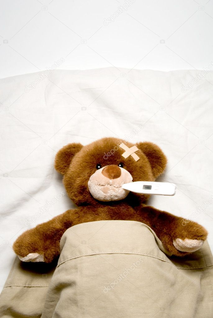 A very Sick Teddy Bear laying in his bed. — Stock Photo #1741862