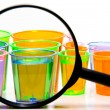 Royalty-Free Stock Photo: Shot Glasses Under a Magnifying Glass