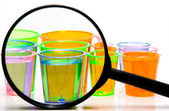 Shot Glasses Under a Magnifying Glass — 图库照片