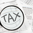 Federal tax forms under a magnifying glass. — Stock Photo #2018760