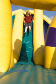 Boy on Inflatable Slide — Stock Photo
