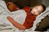 Sleeping with a Football — Stock Photo