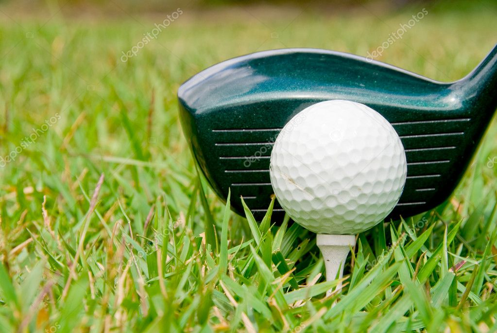 A driver just before it hits a golf ball. — Stock Photo #2013895