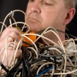 Royalty-Free Stock Photo: Man Tangled in Wires