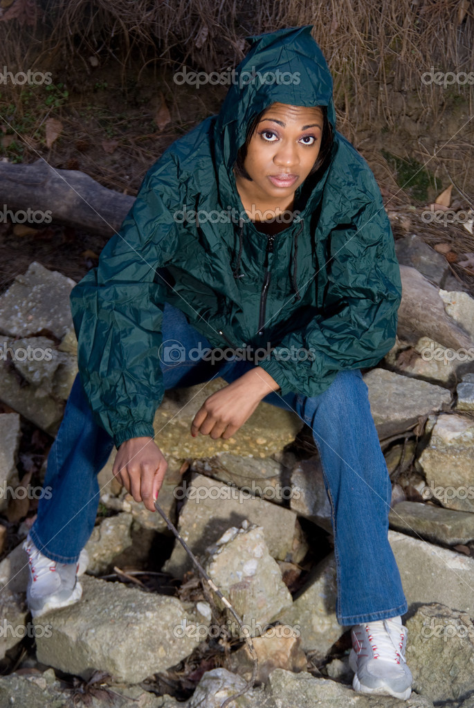 A young African American woman in a raincoat — Stock Photo #2428490