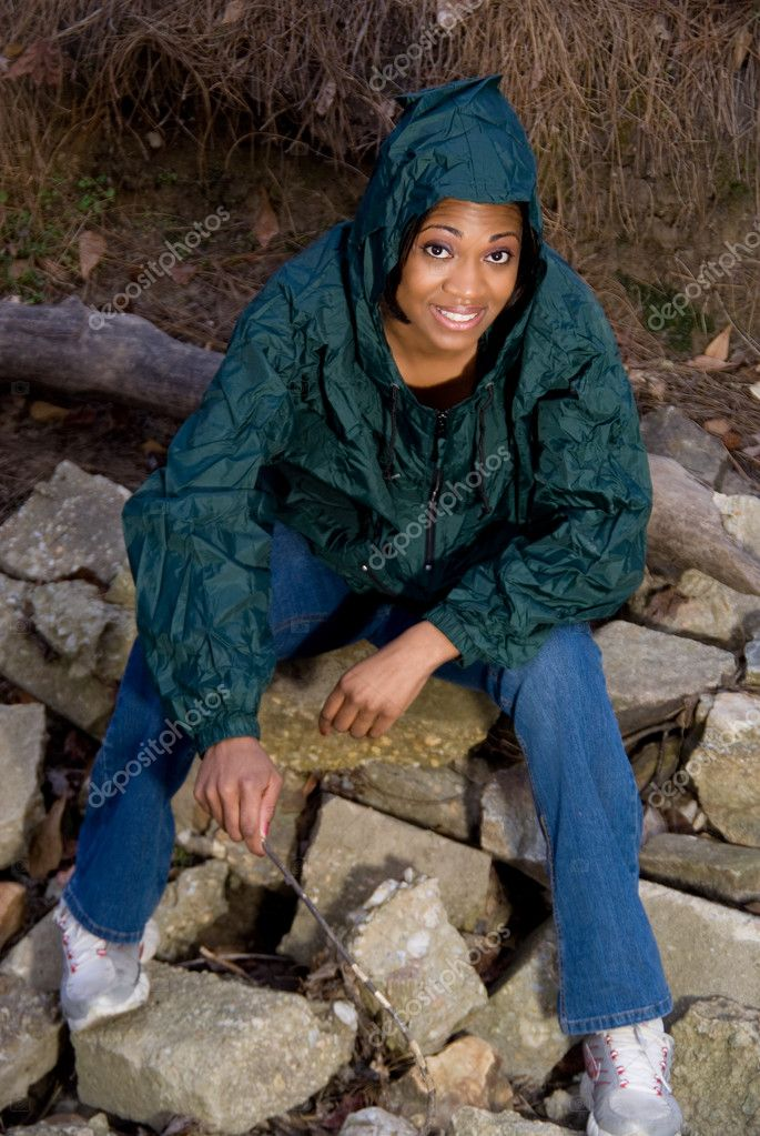 A young African American woman in a raincoat — Stock Photo #2428523