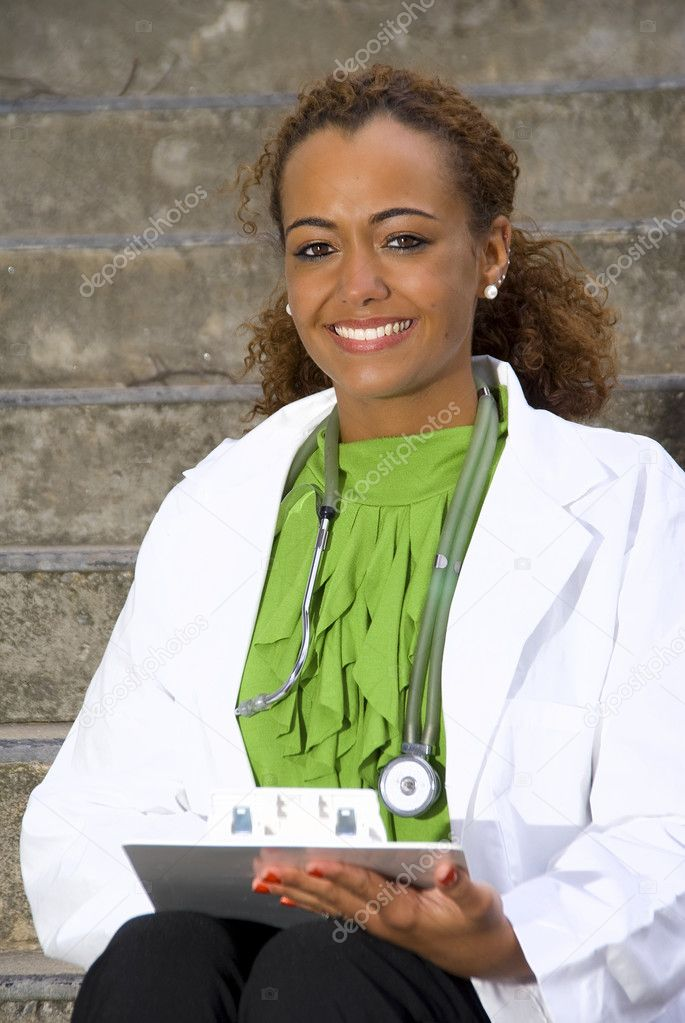 A beautiful female doctor in a lab coat  Stock Photo #2620861