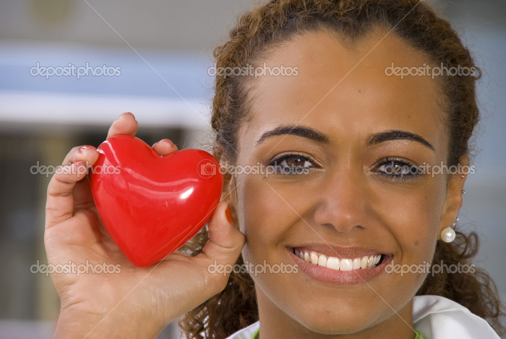 A beautiful cardiologist holding a red heart  Stock Photo #2621030