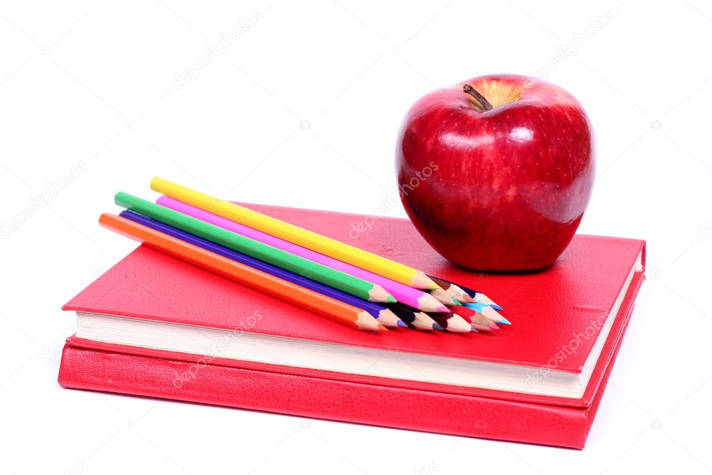 Back to school - red apple and colored pencil on red books (isolated on white background) — Stock Photo #1791956