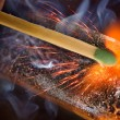 Stock Photo: Igniting match